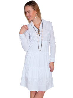 This Scully Womens Pull Over White Western Dress is 100% Peruvian cotton dress is knee length.. This dress features an empire style with long sleeves. This cowgirl dress is a pullover with a four button front closure and point collar.