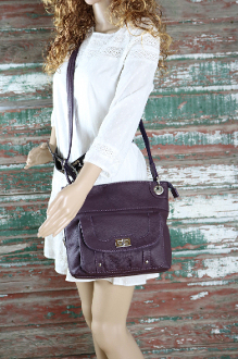 "Our ""JO"" Women's Purple Leather Concealed Carry Purse with Holster has an actual Holster that means no printing on your purse. No printing with this included gun holster for your leather concealed handbag."