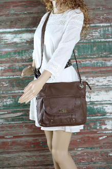 "Our ""JO"" Women's Brown Leather Concealed Carry Purse with Holster has an actual Holster that means no printing on your purse. No printing with this included gun holster for your leather concealed handbag."
