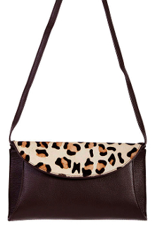 The Cheetah Print Hair on Hide Scully leather Brown Small Handbag is a show stopper for the animal print lover. Soft Pebbled brown leather with hair on hide for a cowgirl look featuring a magnetic snap closure on this western purse.