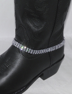 Sparkle and shine with this Triple row Rhinestone boot bracelet made of fine bright rhinestones for your cowgirl boots. This boot chain stands out with 3 rows of faux diamonds that look great on any cowboy boots.