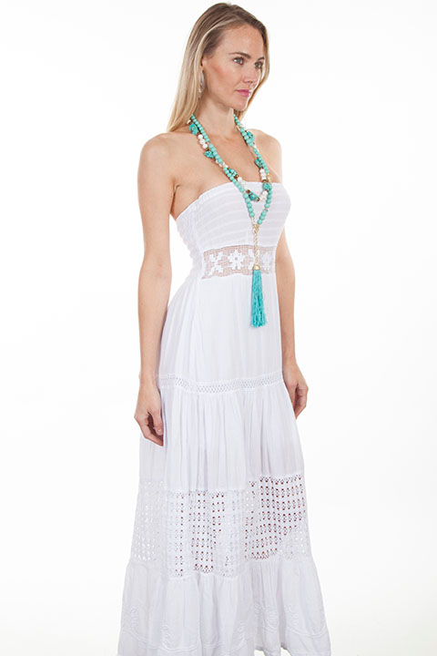 This Womens Peruvian Cotton Full Length White Tube Dress features a lace inset at the waist and smocked top. It has multi panels with crochet panels in the skirt area.