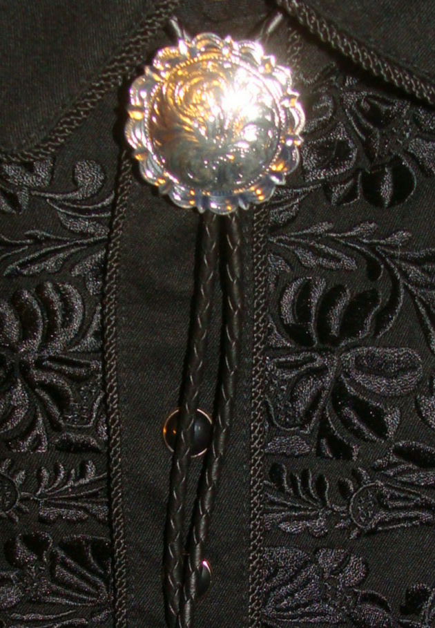 "The ""Rex"" large Silver western bolo tie is a beautiful sterling silver plated cowboy neck tie with elegant engraving and a real southwest flare to dress up any cowboy shirt."