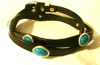 This Sterling Silver Buckle Turquoise stone black leather hat band is hand made in the USA with real stones in a turquoise color with a sterling silver belt buckle closure a great western hat band for cowboys or cowgirls.