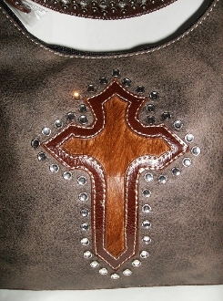 This Cross inlay brown hair on hide rhinestone western purse is a great find at a discounted price. This ladies handbag is cute and durable for any western cowgirl.