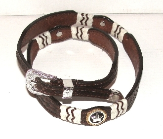 This Brown basketweave leather Rawhide star hat band is hand made in the USA with real leather rawhide and sterling silver plated conchos with a sterling silver belt buckle closure a great western hat band for cowboys or cowgirls.