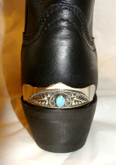 These Vine filigree Silver Cowboy boot heel guards have are Turquoise stone on a silver plated full coverage for the back of your western cowboy boot with a one size fits most back heel guard.