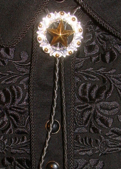 "The ""Western Star"" Silver, Gold western bolo tie is a beautiful sterling silver and gold plated western star cowboy neck tie with engraving gold studs to add a real old west that will dress up any cowboy or cowgirl shirt."