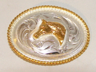 This Kids Sterling Silver Gold Horse head Western Belt Buckle is made for the little gals or guys to go on a cowboy belt with this beautiful etched Sterling silver oval shaped belt buckle with a gold horse head.