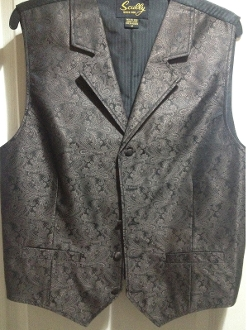 This Scully Mens Brown Paisley Dress Lapel western vest for western weddings or cowboy western dress vest with classic paisley print covered button front and welt pockets with back adjustable strap.