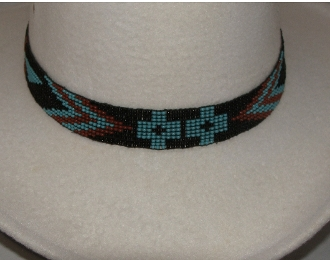 This Turquoise and Black horse hair tassel hat band has the fire bird native design beaded into this fine detailed band for cowboys and cowgirls each bead is hand made and hand strung real horse hair.