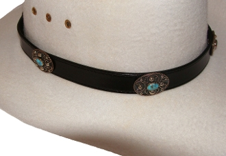 This Black leather Turquoise Oval Silver Buckle hat band is hand made in the USA with genuine stone died in the turquoise color with a sterling silver belt buckle closure a great western hat band for cowboys or cowgirls.