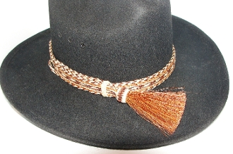 "The 1"" Tri Color Brown Horse Hair Side Tassel Hat Band is hand made in the USA with genuine horse hair that is hand weaved with a thick horse hair tassel adding detail to any cowboy or cowgirl hat."