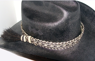 "The 1"" Black, White Horse Hair Side Tassel Hat Band is hand made with genuine horse hair that is hand weaved with a thick horse hair tassel adding detail to any cowboy or cowgirl hat."