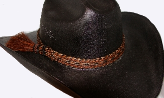 "The 1"" Brown Horse Hair Side Tassel Hat Band is hand made in the USA with genuine horse hair that is hand weaved with a thick horse hair tassel adding detail to any cowboy or cowgirl hat."