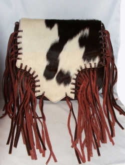 "This ""Dakota"" Scully Women's Brown Leather Hair on Hide fringe Western Purse is a hand whip stitched cowhide hair unique handbag with a magnetic flap closure at 15"" long x 10"" high"