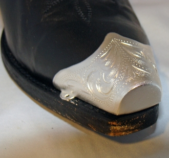 These Laser Etched Silver Cowboy Boot Tips are a full coverage to dress up your cowboy boots or protect them from normal wear with silver plated toe rands.