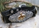 This Silver Horse Concho Black Leather Western Bracelet is made in the USA with sterling silver and gold plated center with rhinestone studded accents and a silver belt buckle closure a real cute cowgirl look.