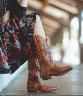 These Valencia Hand Crafted leather Blue Bird Cowgirl boots are made for the cowgirl who loves the quality and feel of handmade cowboy boots blue bird decorative touch made with tanned leather leather western heel.