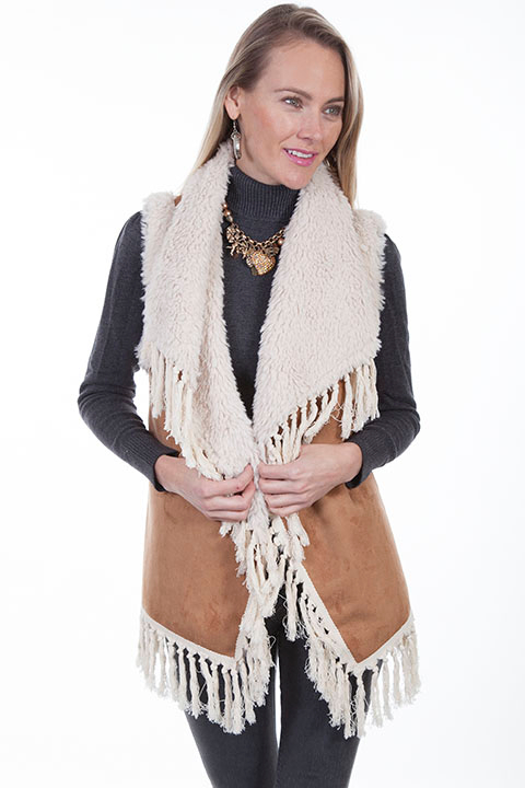 This Womens Scully Faux Sherling Tan Knotted Fringe Vest is a playful faux fur vest with faux shearling collar and lining embellished with knotted fringe around the perimeter.The faux suede body is 100% polyester.