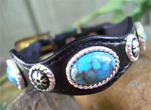 This Silver Concho Black Leather Turquoise Bracelet is made in the USA with real stones with a turquoise stain and sterling silver plated studs and accents and a silver belt buckle closure a real cute cowgirl or cowboy look.
