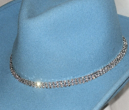 This 3 Row Sterling Rhinestone Crystal Cowboy Hat Band is hand made with genuine rhinestones and sterling silver plated that really adds style to any cowboy or cowgirl hat a great rodeo show stopper.