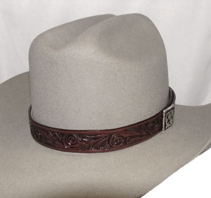 "This 1"" Carved leather Brown hat band is a simple tooled leather band made in the USA. This leather cowboy hat band features a silver side concho with a hidden hook for keeping the leather band in place on your cowboy hat."