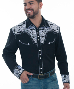 "This ""Gunfighter"" Mens White Embroidered Black Western Shirt is a western favorite with the beautiful vintage smiley pockets and retro floral embroidered yoke complete with pearl snaps to make this a great cowboy shirt."