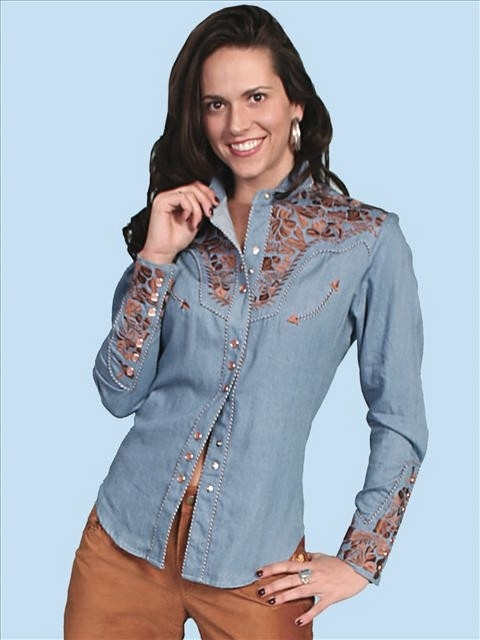 "This ""Blue Jean Gunfighter"" Womens Scully Embroidered Western Shirt with embroidered floral top and back yokes with twisted piping and smiley pockets closed up with matching pearl snaps make a great country western shirt for the ladies."
