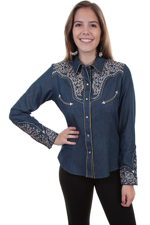 This Scully Women's Scroll Embroidered Denim Western Shirt is heavily embroidered on the front and back yokes with retro piping and pearl snaps including smiley pockets and a twisted piped vintage look.
