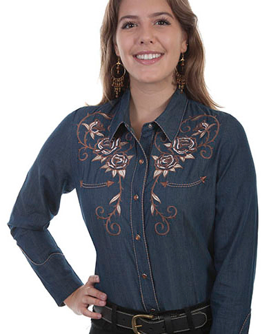 This Scully Women's Rose Embroidered Denim Western Shirt is heavily embroidered with roses on the front and back yokes rose sleeves and twisted piping with smiley pockets and pearl snaps.