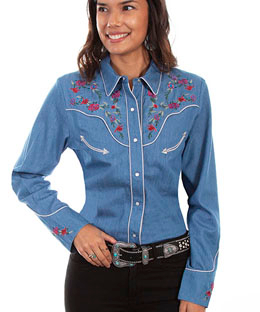 This Scully Womens Summer Floral Blue Denim Western Shirt is a lightweight beautiful summer flowers embroidery on front back yokes piped smiley pockets and pearl snaps a sassy cotton western shirt for women.