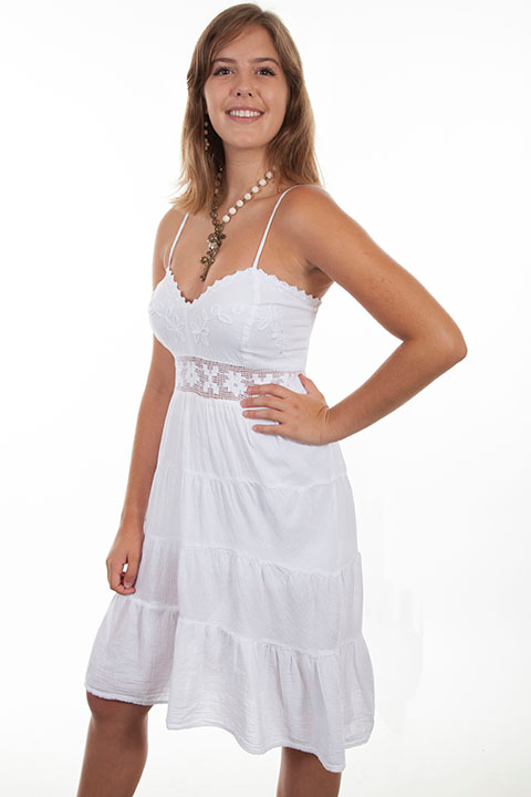 This Womens Peruvian Cotton White Spaghetti Dress is 100% Peruvian cotton dress that features adjustable spaghetti straps, a lace inset at the waist, soutashe on the bodise with crochet edging and multi paneled skirt