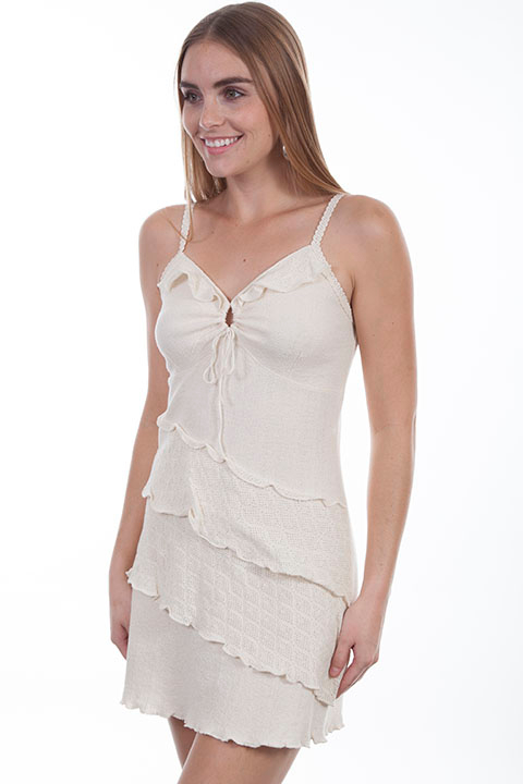 This Womens Peruvian Cotton Natural Front Ruffle Halter Dress is 100% Peruvian cotton dress that features a key hole front with tie. A great country looking dress with crochet straps that run along the underarms and front ruffle trim.