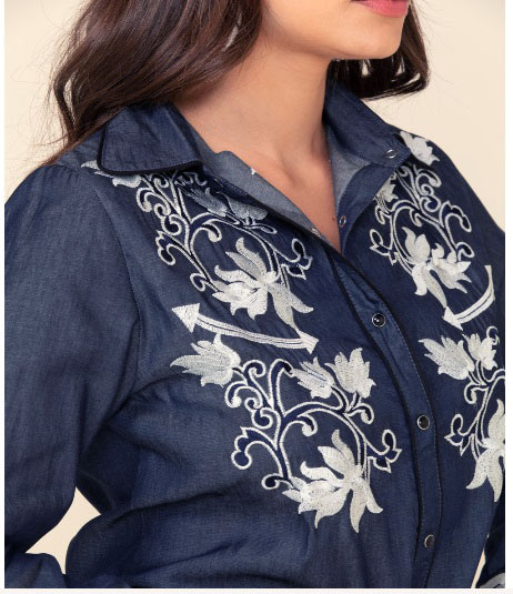 Scully Womens Chambray Denim western Shirt with heavily embroidered floral top back yokes and sleeves has retro smiley pockets closed up with matching pearl snaps make a great country western shirt for the ladies.