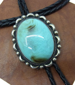 This Large Oval Turquoise Western Bolo Tie is made in the USA and makes a beautiful statement for any cowboy or cowgirl shirt.