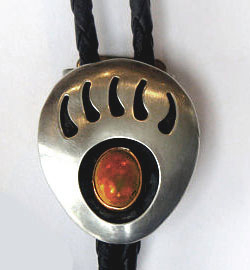 The Silver Bear Claw Tiger Eye Bolo Tie is a beautiful sterling silver plated large bolo in a bear claw design with a tiger eye center stone and black enamel that will dress up any cowboy or cowgirl shirt.