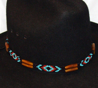 This Brown Cow Bone Turquoise Beaded Hand Beaded Cowboy Hat Band is hand made in the USA with genuine horse hair tassels closure with turquoise black and rust beads for all cowboys and cowgirls.