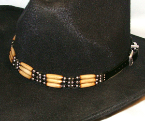 This Sterling Silver Black Onyx beaded Cow Bone hat band is hand made in the USA with quality bones and beaded accents really makes any cowboy or cowgirl hat look much better.