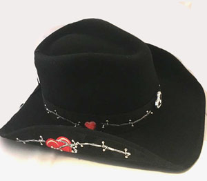 This Valentine Womens Black Wool Red Heart Cowboy Hat is made of soft wool with a shape-able brim and silver studded accents with a rhinestone heart center hat band and embroidered barbed wires and red hearts