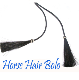"This Black Horse Hair Bolo Tie String with Tassel is made in the USA with cruelty free horse hair in a 42"" long bolo string for a replacement or to where by itself making a great cowgirl or cowboy western look for any occasion."
