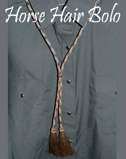 "This ""Tabiano"" Black, Sorrel Horse Hair bolo tie is made in the USA with cruelty free horse hair in a 42"" long bolo string for a replacement or to where by itself making a great cowgirl or cowboy western look for any occasion."