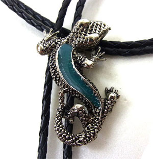 This Turquoise Lizard Silver Bolo Tie is made in the USA with long detailed lizard filled with turquoise enamel on a black bolo string great on a cowboy shirt.
