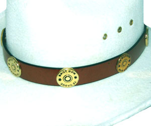 This Brass Shotgun Shell Brown Leather Cowboy Hat Band has gun shell conchos on a real leather band with silver buckle end tip and keep for any shooting cowboy or cowgirl.
